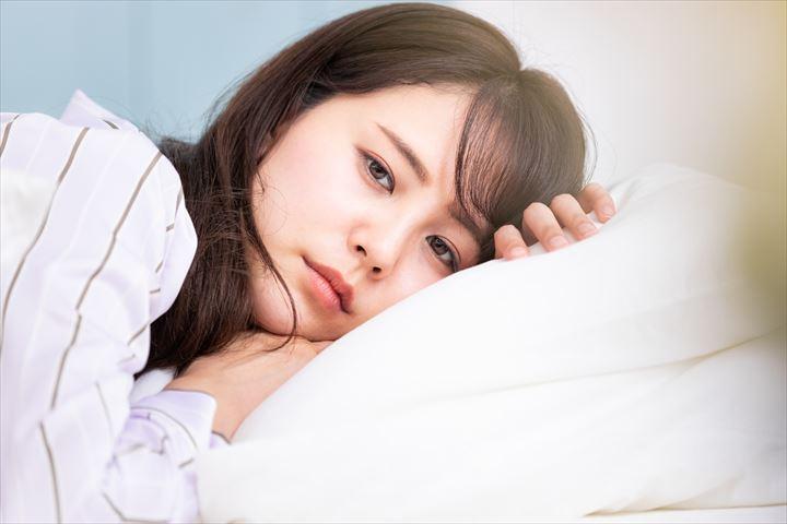 疲弊する女性